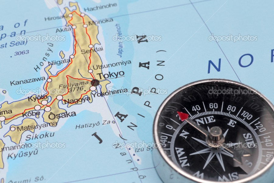 Travel destination Tokyo Japan  map with compass     Stock Photo     Compass on a map pointing at Japan and planning a travel with destination  Tokyo     Photo by MattiaATH