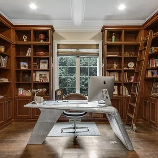 75 Most Popular Traditional Home Office Design Ideas for 2018     Inspiration for a timeless freestanding desk dark wood floor and brown  floor study room remodel in