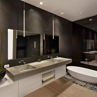 Luxury Master Bathroom Designs   Houzz Freestanding bathtub   large contemporary master black tile and ceramic  tile concrete floor and gray floor