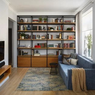 Blue And Brown Living Room Ideas   Photos   Houzz Example of a trendy enclosed light wood floor and brown floor living room  library design in