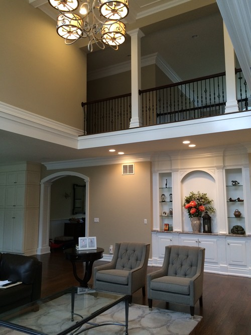 Two Story Fireplace And Built In Bookshelves