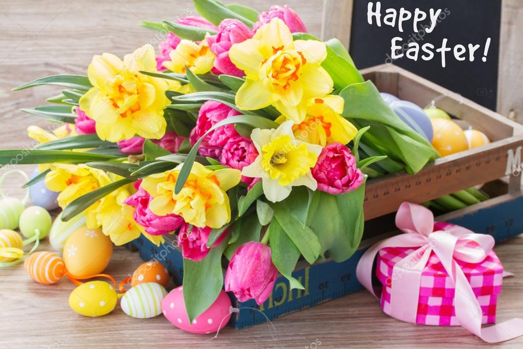 spring flowers bouquet with easter eggs     Stock Photo      Neirfys     Spring pink tulips and yellow daffodil flowers with easter eggs and gift  box     Photo by Neirfys