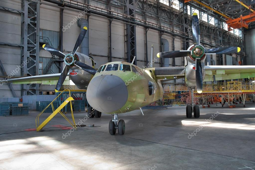 Aircraft manufacturing hangar     Stock Editorial Photo      dragunov     Kiev  Ukraine   August 3  2011  Antonov An 32 cargo plane being assembled  at the aircraft manufacturing hangar     Photo by dragunov