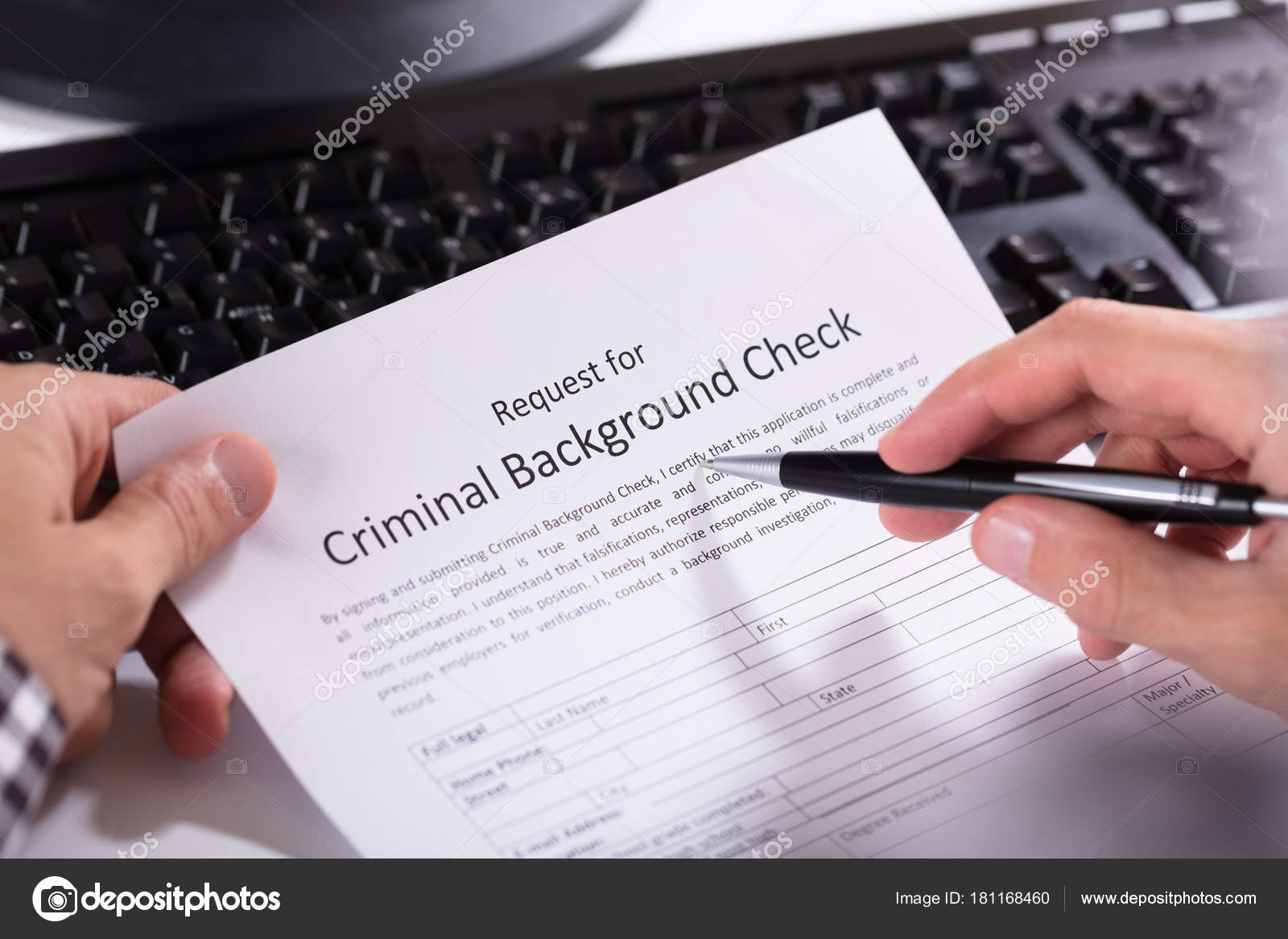 Close Person Hand Filling Criminal Background Check Application Form     Close Person Hand Filling Criminal Background Check Application Form      Stock Photo