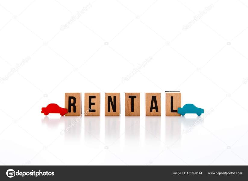 Car Rental   wooden block letters on white reflective background     Car Rental   wooden block letters on white reflective background with red  and blue wood car shapes     Photo by Creativefire