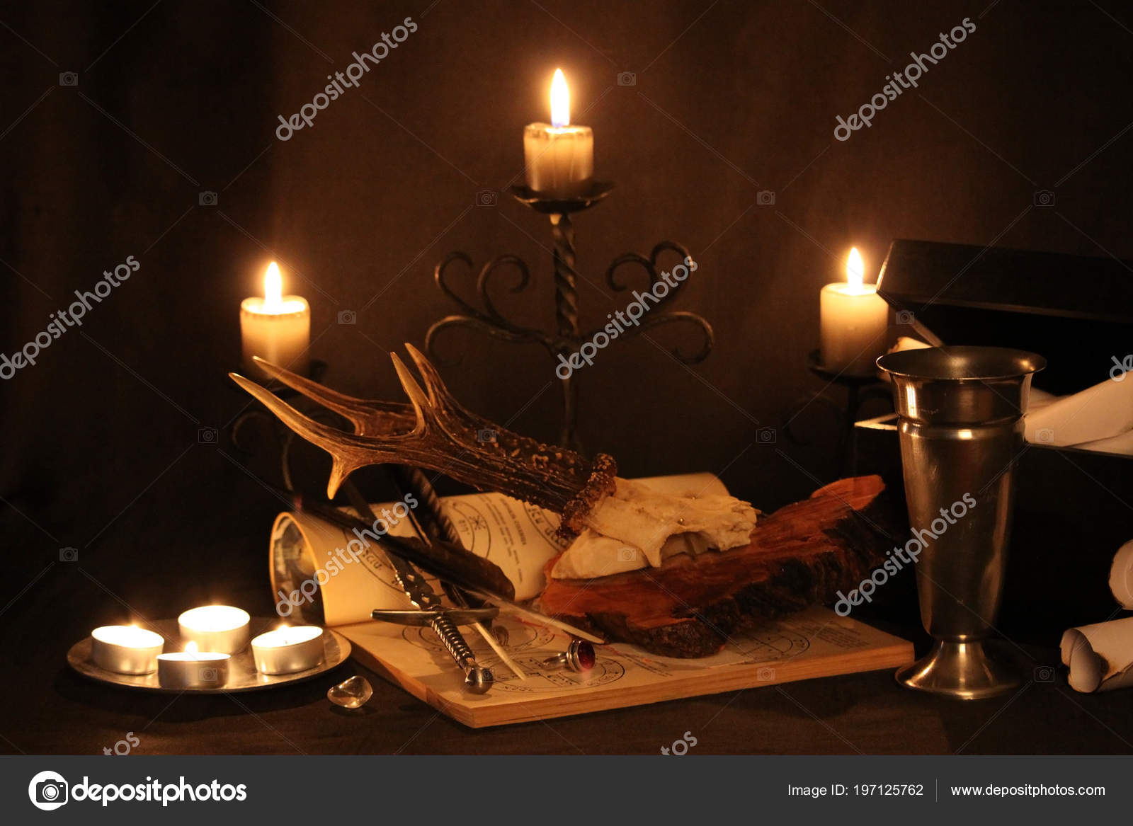 Black Magic Spells Wiccan Spells Herbs Still Live Old Oil     Stock     Black Magic Spells  Wiccan spells and herbs  Still Live  Old oil lamps   antique books  dried rose buds  a burning candle in a copper bowl  medicine  bottles