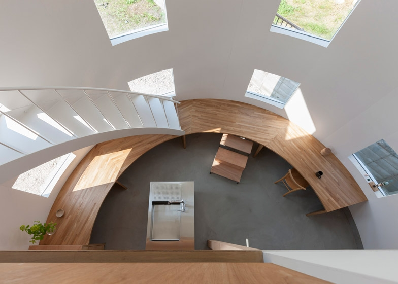 A Staircase Lands On A Desk Inside House By Tato Architects | Staircase Inside House Design | Spiral Stair Case | Stair Railing | Modern Staircase Ideas | Steel | Staircase Makeover