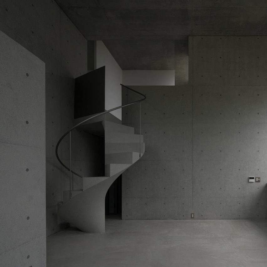 Concrete Spiral Staircase Disrupts Linear Interiors Of House In | Spiral Staircase For Sale Ebay | Stair Railing | Stair Case | Wrought Iron Spiral | Handrail | Attic Stairs