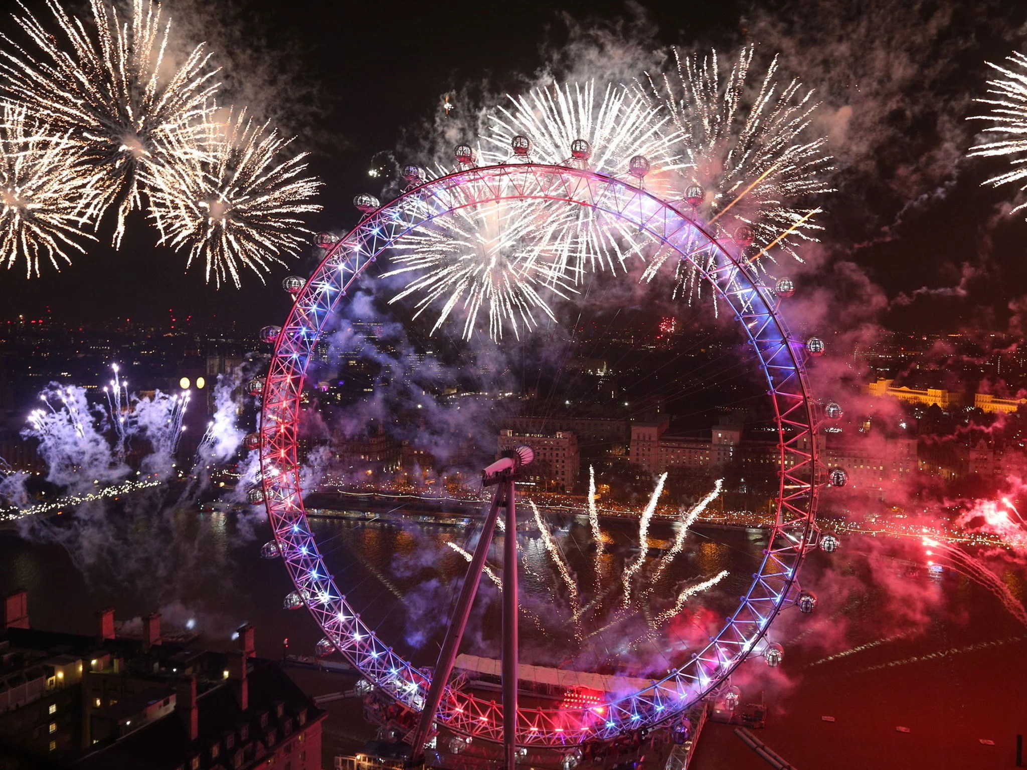 New Year  Spectacular firework displays light up London and     Fireworks light up the sky over the London Eye in central London during the New  Year