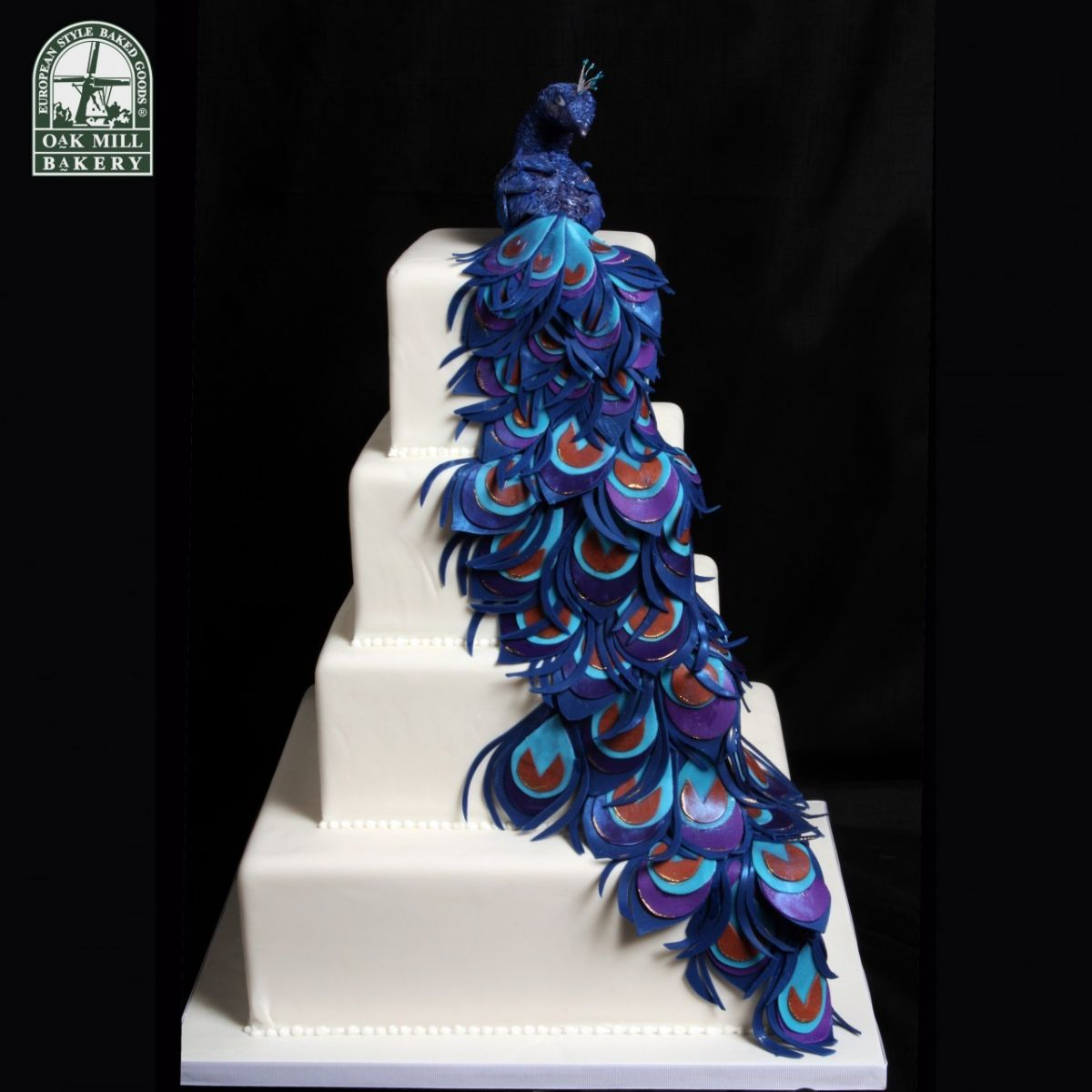 18 Wedding Cake Designs to Steal   AllFreeDIYWeddings com This cascading peacock cake is absolutely stunning  The simplicity of the  left side of this wedding cake design perfectly foils the intricacy of the  right