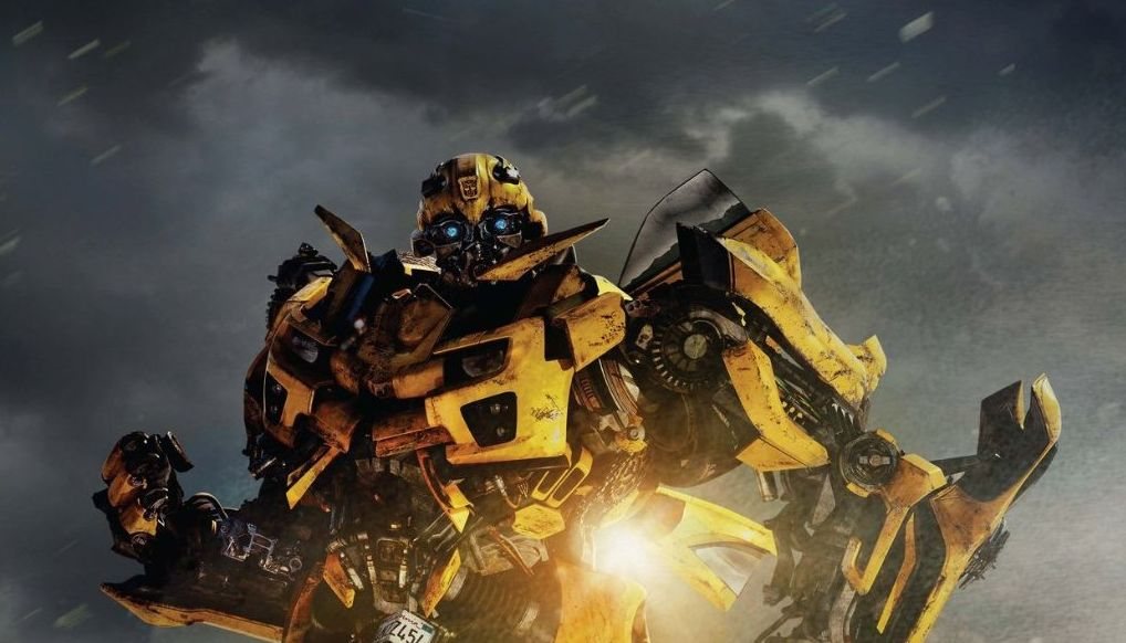 TRANSFORMERS: DARK OF THE MOON poster featuring Bumblebee ...