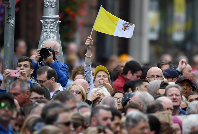 Pope in Ireland  Francis Meets Church Abuse Victims   The New York Times A woman waved the flag of Vatican City as she waited for Pope Francis to  travel through Dublin  Credit Jeff J Mitchell Getty Images