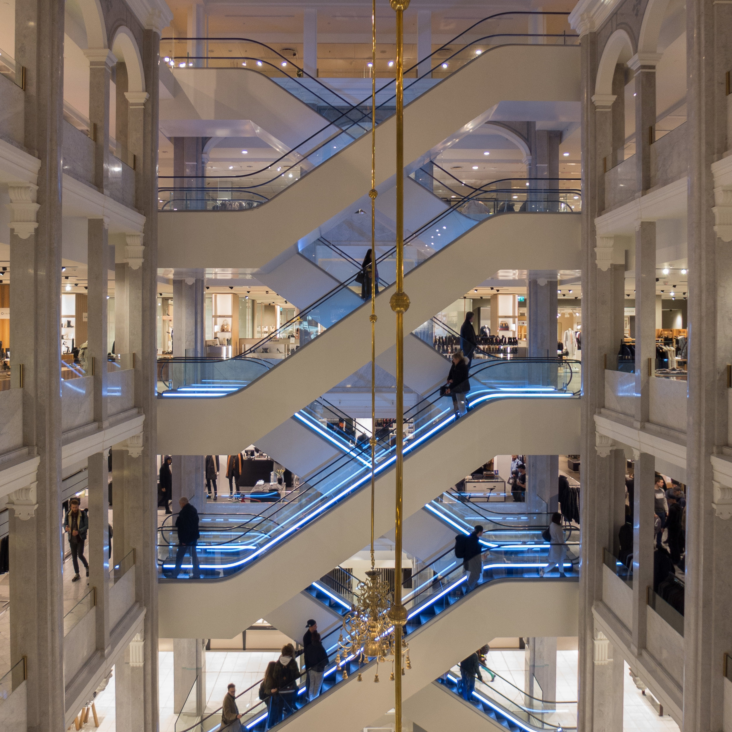 Just How Difficult Can It Be To Design A Staircase — Danish | Staircase Design For Commercial Buildings | Cylindrical Glass | Enclosed | Beautiful | Central Staircase | Sleek