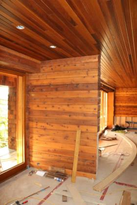 Installing wood paneling     Conrad Contracting Inc  This is our Madrona Drive project  clad in Cedar paneling for walls AND  ceiling