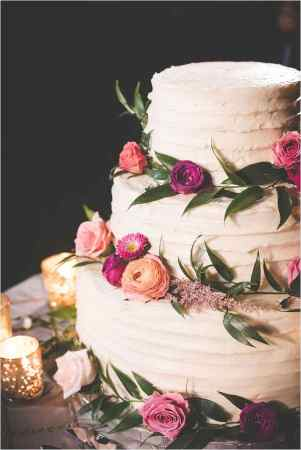 20 Beautiful Buttercream Wedding Cake Ideas     the bohemian wedding Buttercream with Greenery and Flowers