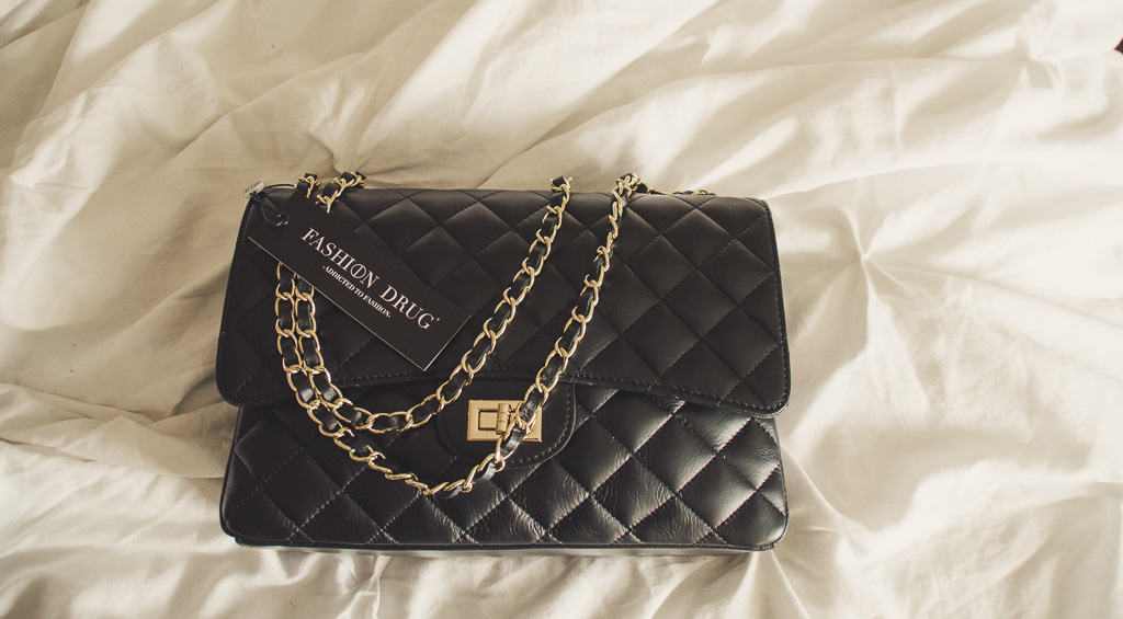 Fashion Drug  A Company and Product Review     Lady Out Loud The bag itself is structured  with a hard sided bottom  and a beautifully  leather threaded gold chain  The hardware is in no way garish or gaudy