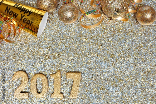 New Years Eve top border of streamers and decor with 2017 numbers     New Years Eve top border of streamers and decor with 2017 numbers over a  golden background