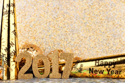 New Years Eve 2017 border of noise makers and golden decor with     New Years Eve 2017 border of noise makers and golden decor with twinkling  light background