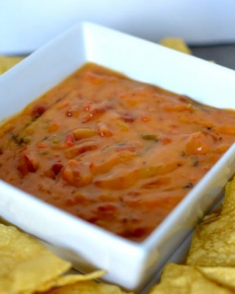 Looking for a spicy cheesy snack for game day? Check out this 2 ingredient queso dip and print your Ro*tel B3G1 coupon! #JustAddRotel #ad #CollectiveBias