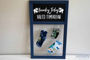 Make this laundry room sign to keep track of lost socks. FREE SVG included!