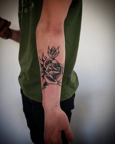 traditional black rose tattoo
