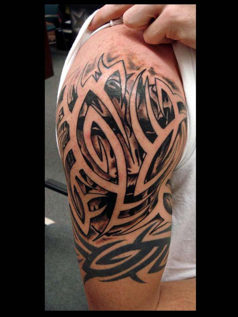 Amazing Tribal Tattoo Design On Shoulder For Men Ideas And Designs