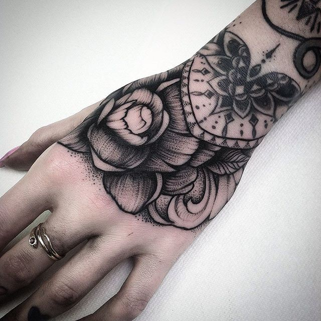 Engraving Style Black Ink Wrist Tattoo Of Big Rose And Ideas And Designs