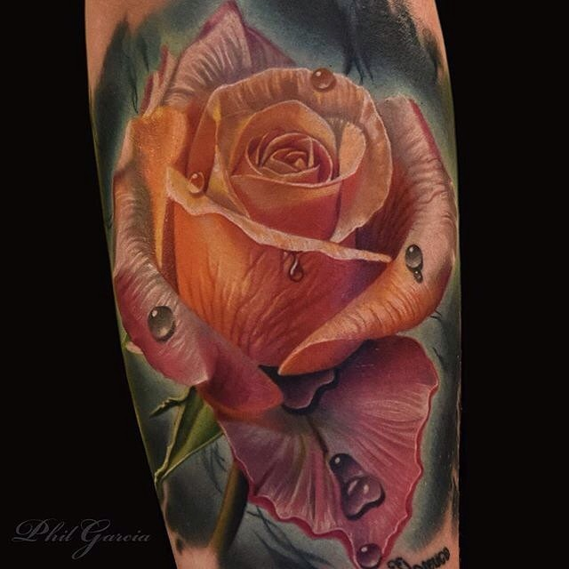 Realistic Looking Colored Rose Tattoo On Arm Ideas And Designs