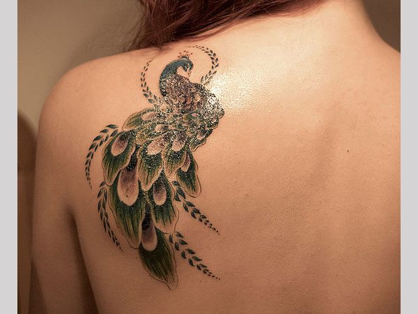 26 Arresting Female Back Tattoos Ideas And Designs