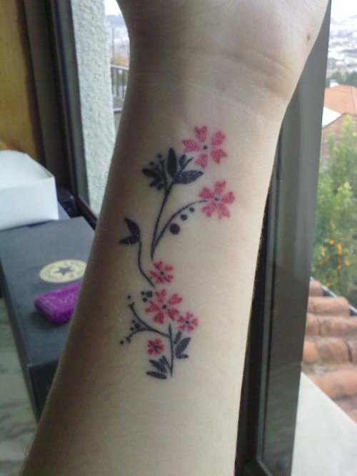 Small Cherry Blossom Branch Tattoo On Wrist Ideas And Designs