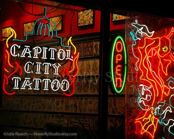 Neon Signs In A Shop Window At Night Capitol City Tattoo Ideas And Designs