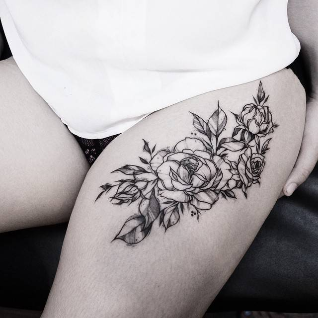 Thigh Tattoo Of A Bunch Of Roses Ideas And Designs