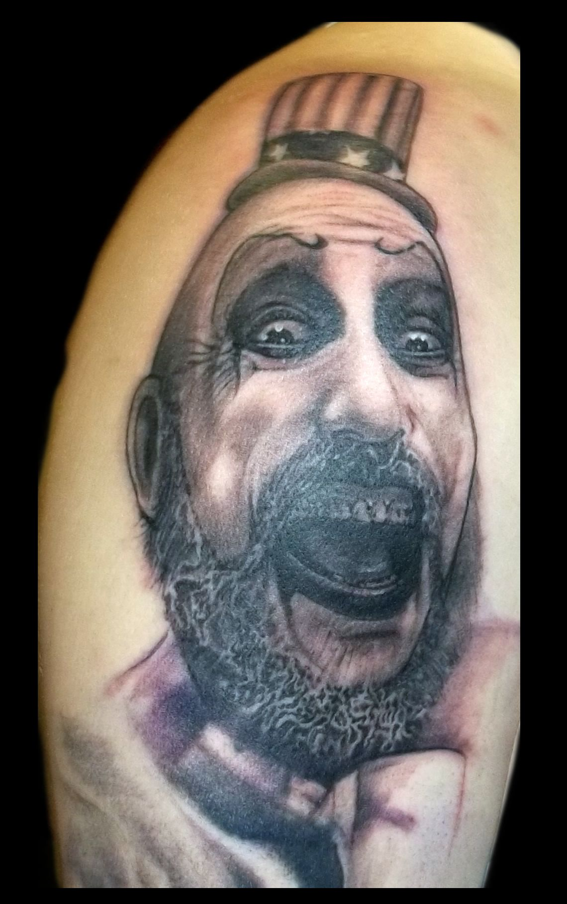 Black And Grey Captain Spaulding Portrait Done By Ideas And Designs
