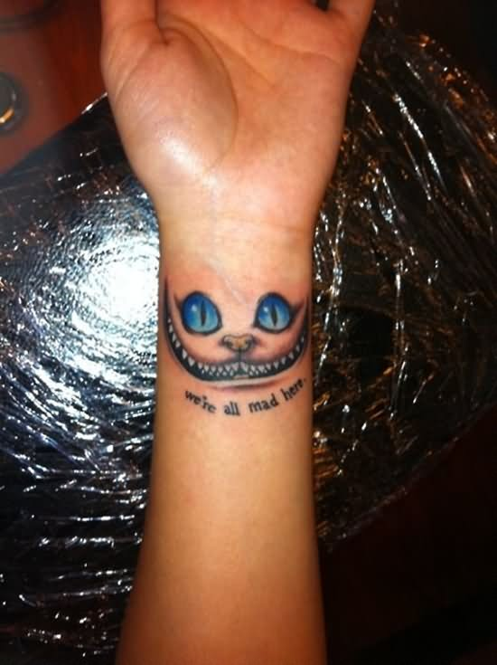 We Are All Mad Here Cheshire Cat Tattoo On Left Wrist Ideas And Designs
