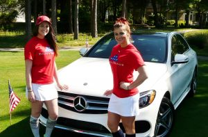 Caddy Girl volunteers with the 2015 Tournament HIO car