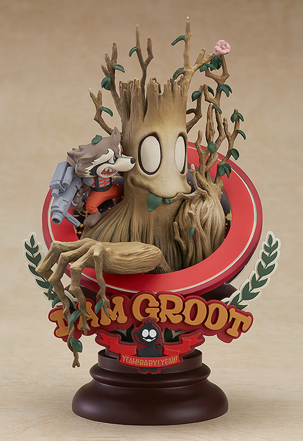 A Cute Statue Of Groot And Rocket Based On A Manga Comic Book Cover