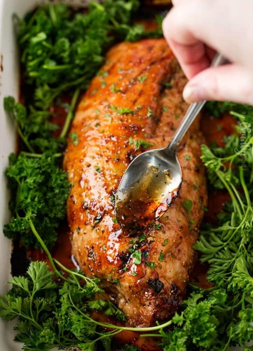 Stuck in a weeknight dinner rut? Try this oven roasted pork tenderloin that's marinated, seared, roasted and basted with plenty of the extra marinade for maximum flavor! The best part? It's ready in less than 30 minutes!!
