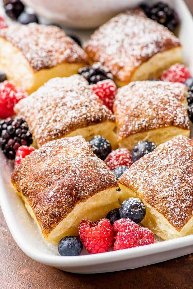 Fluffy Puff Pastry squares topped with a baked layer of cinnamon sugar and served with homemade vanilla whipped cream for dipping.