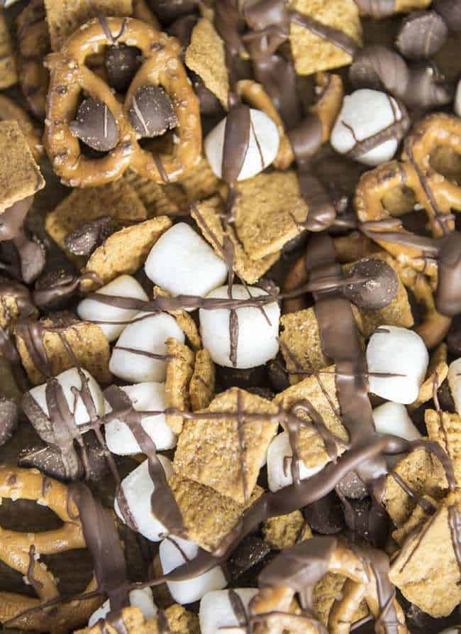 If you haven't made anything s'mores yet this summer, then you are severely missing out - but this s'mores snack is the perfect place to start! This S'mores Snack Mix is full of golden graham cereal, mini marshmallows, pretzels, and chocolate chips and so easy to throw together!
