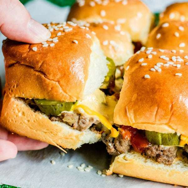 Copycat Big Mac Sliders are an easy appetizer recipe filled with beef, cheese, and McDonald's Big Mac sauce!