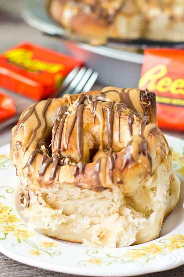 Reese's Stuffed Sweet Rolls… Why not have Reese's peanut butter cups for breakfast? Peanut butter cream and Reese's are stuffed inside this homemade bread. Such a sweet way to start your day!
