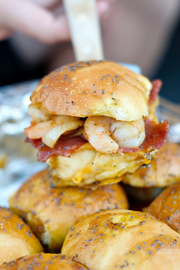 Enjoy these delicious Shrimp Bacon Sliders for easy entertaining and holiday fun! Serve them hot, or wrap in foil and bring them to the party! Watch the VIDEO below to see how easy they are to make!