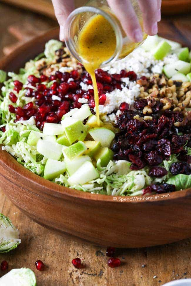 Brussels Sprout Salad. Shredded Brussels sprouts,crisp tart apples, feta cheese, cranberries, pomegranate arils and walnuts all tossed in a tangy honey dijon vinaigrette. This makes a perfect side or lunch.