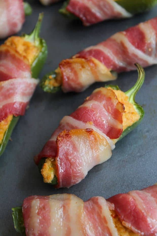 Paleo Jalapeño Poppers – jalapeño stuffed with a dairy free cashew cream, wrapped in a slice of bacon and baked to crispy perfection. It's an umami party for your mouth!