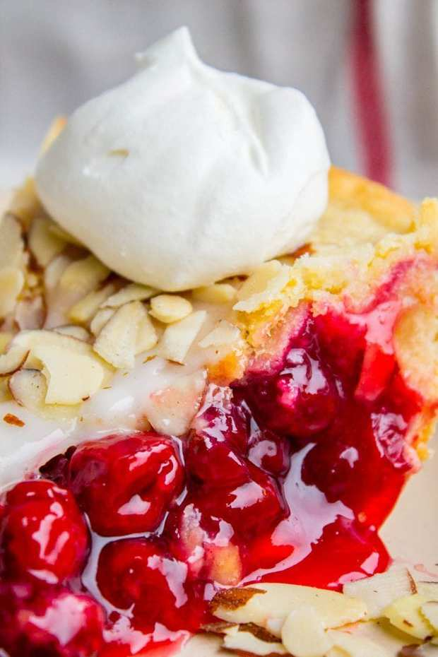 Cranberry Cherry Pie is just what you need for Thanksgiving! It's has perfect pops of tart from of the cranberries. The almond glaze on the top adds the perfect crunch!