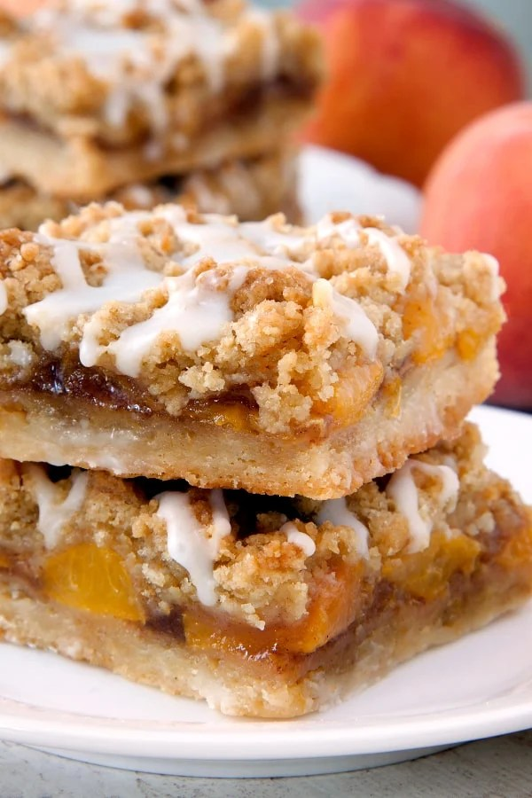Peach Crumb Bars have a shortbread-like crust, cinnamon-spiced peach layer and a brown sugar crumb topping. So perfect for summer! Recipe contains a gluten-free option.