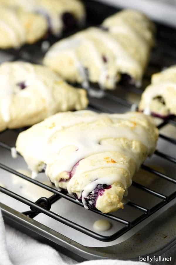 Blueberry Lemon Scones – tender flaky scones with fresh blueberries throughout and a dreamy lemony glaze!