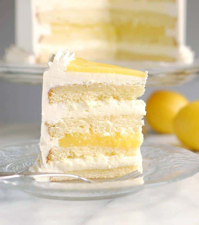 Luscious lemon mousse cake might be the perfect layer cake. Lemon cake with Limoncello syrup, zesty lemon curd and creamy lemon mousse.