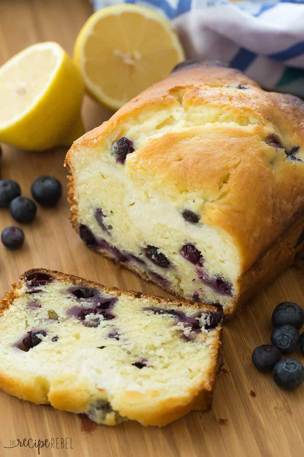 This Cream Cheese Filled Blueberry Lemon Bread is sweet, tangy and filled with a decadent cheesecake layer! Let's call it breakfast or dessert.