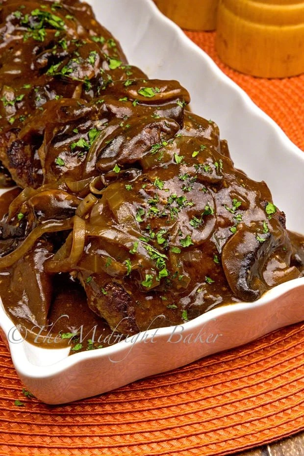 Soft chopped sirloin patties with a savory gravy is a perfect, and easy weeknight meal. Surprise ingredient flavors the meat and the gravy!